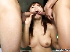 Close up scenes with two dicks packing her mouth