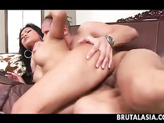 Bosomy Asian moves pussy and ass on the dick