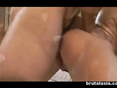 Two Asian girls licking nubs and getting probed
