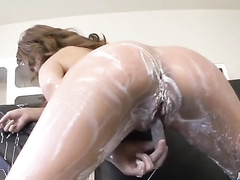 Sultry foamed Asian plunges into bath masturbation