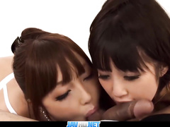 Two Asian chicks touch stiff dick with the tongues