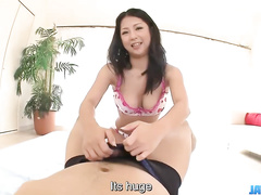 Busty Asian plays with cock in all possible ways