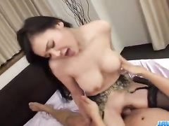 Busty Asian in stockings on two hard pistons
