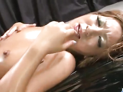 Japanese slut with awesome body gets oiled up and fucks with two guys