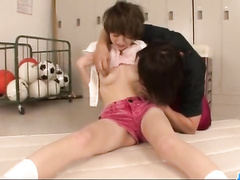Handsome Japanese guy excitingly kissing and fondling his girlfriend