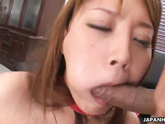 Big-breasted Japanese redhead gives a good titjob