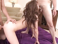 Sexy hot redhead Asian chick is being pleasantly fucked by two guys