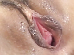 Tight young boobed Asian chick enjoys sucking two dicks