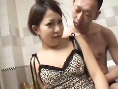 Japanese babe in sexy short leopard dress is getting oiled up