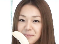 Japanese chick sexily eats banana before sucking boyfriend's dick