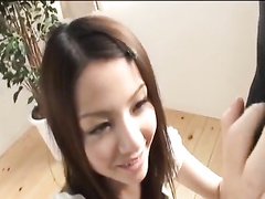 Young Japanese chick gets down on her knees and sucks hairy dick