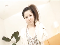 Pretty young Japanese girl is hotly posing and undressing