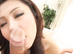 Adorable Asian girl is being undressed and sucking dick