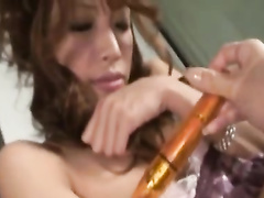 Attractive young Japanese chick enjoys pussy masturbation