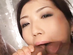 Beautiful Japanese slut is getting hotly fucked in cunt and mouth