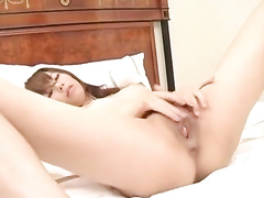 Pretty young Asian couple hotly kisses in hole way
