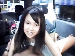 Charming young brunette Asian babe sucks dick in the car