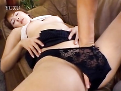 Japanese adult dude is lying on top of young chick and hotly kissing her