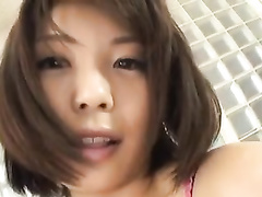 Adorable Japanese chick is hotly undressing and masturbating