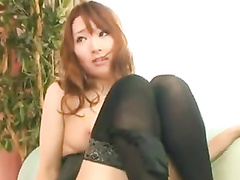 Steaming hot Japanese chick is hotly fondling herself and masturbating pussy