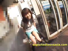 Naughty teen Asian girl is walking around the town with holes on the ass and pussy