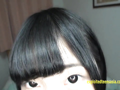 Japanese teen Reina Tsukimoto is being stroked with vibrator sex toy